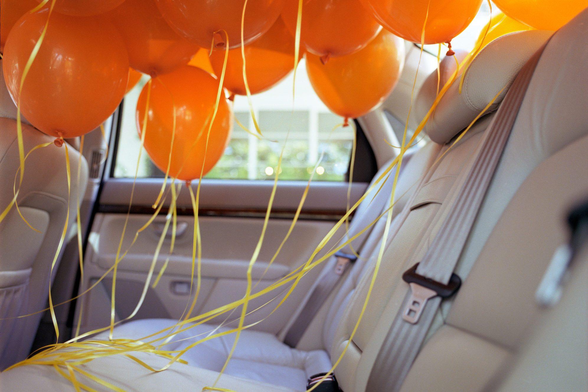 Orange balloons in back seat of car