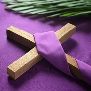 cross and palm leaves on purple background to symbolize Good Friday, Lent Season and Holy Week