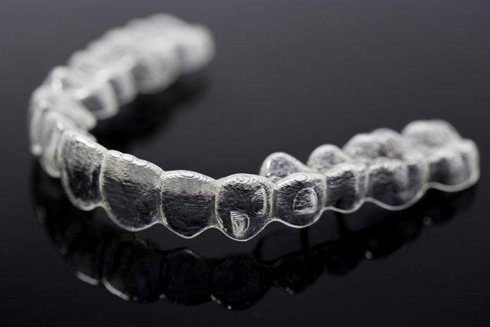 Invisalign braces close up on black
