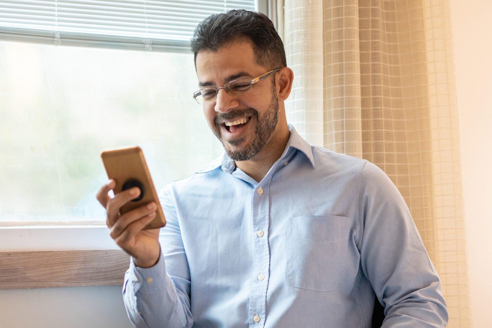 Portrait of confident businessman using smart phone