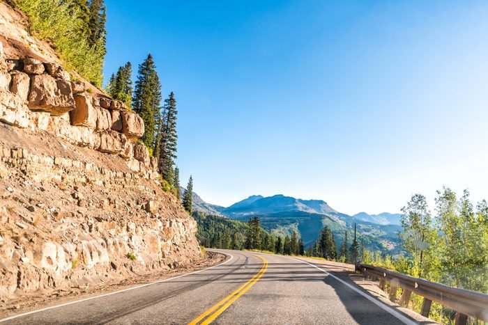 Colorado Million Dollar Highway 550 scenic road wide angle view with San Juan rocky mountains peak view to Silverton from Durango