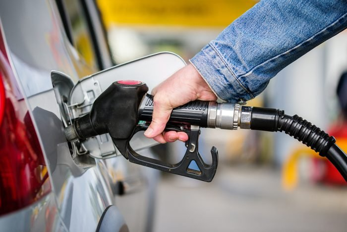 Cropped Hand Of Man Refueling Gas In Car At Gas Station