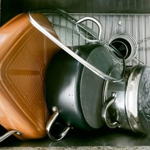 Pots Drying Off in Kitchen Sink