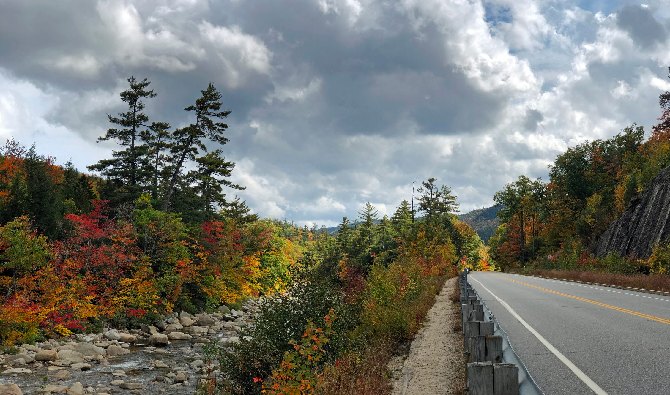 Kancamangus Highway in the New Hampshire White Mountains running alongside the Swift River during Autumn