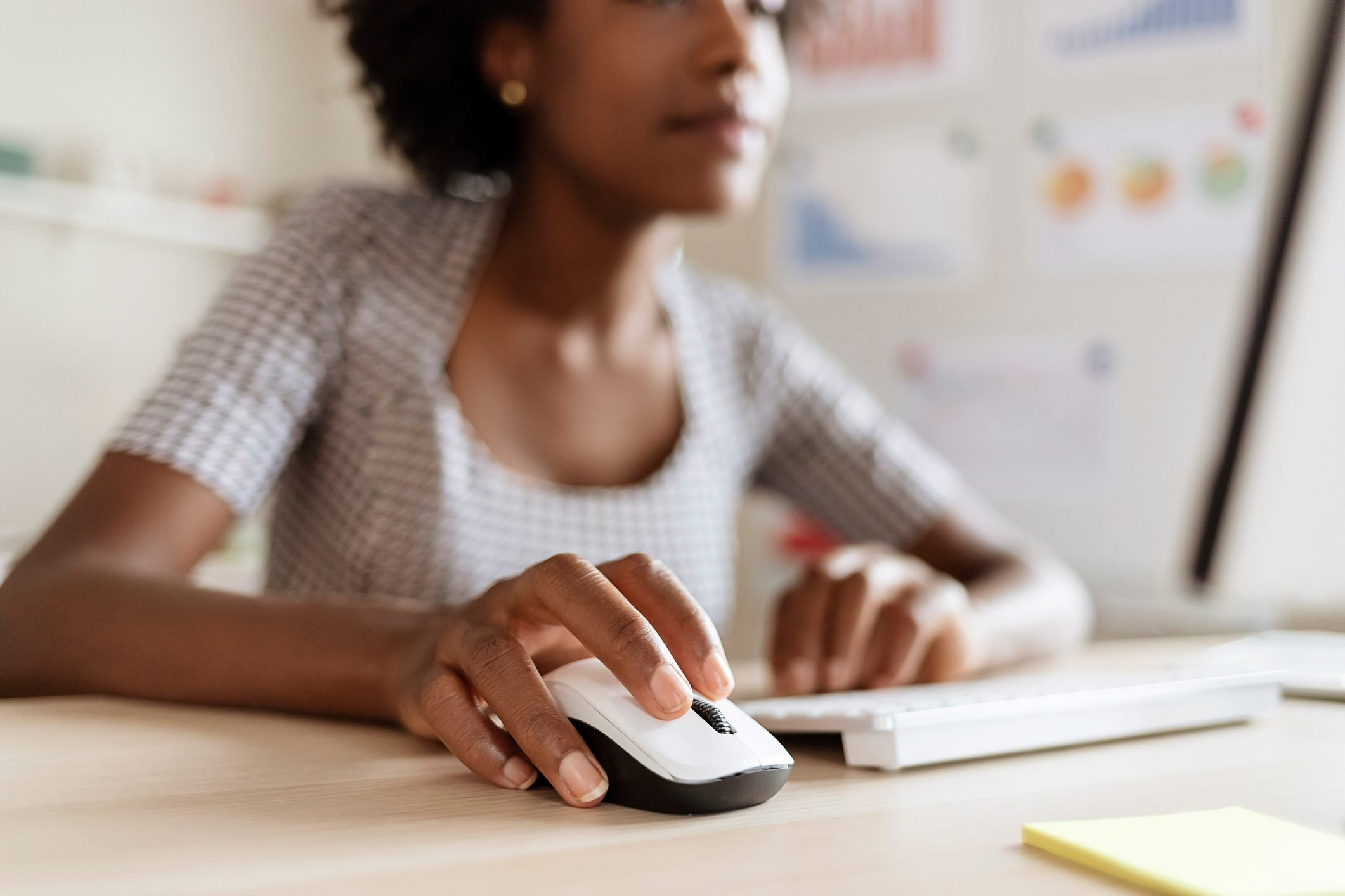 Close Up of a Business Woman using Computer Mouse