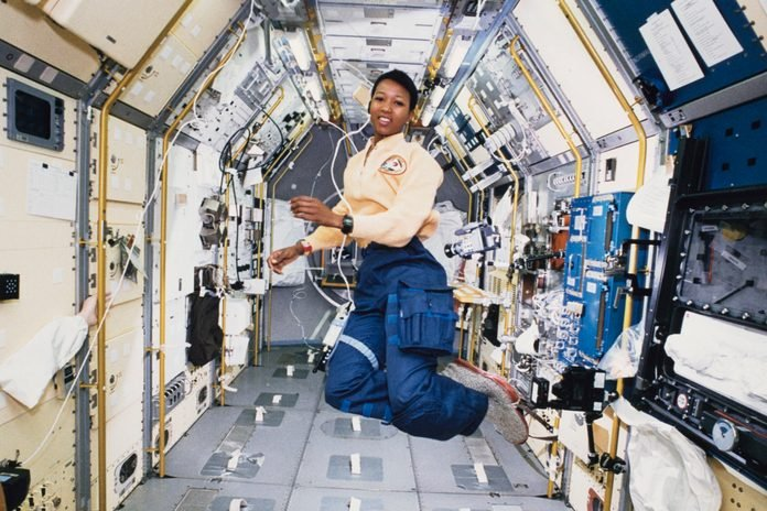 Mae Jemison works in zero gravity in the centre aisle of the Spacelab Japan (SLJ) science module aboard OV-105, the Space Shuttle Endeavour, during NASA's STS-47 mission, 20th September 1992.