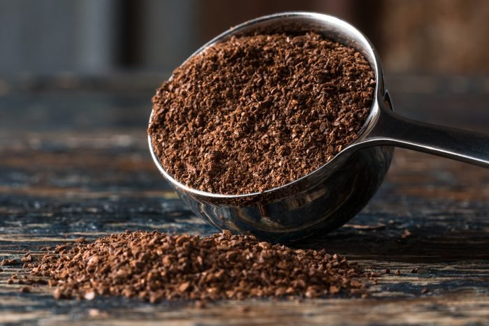Ground Coffee Beans Spilled from a Coffee Scoop