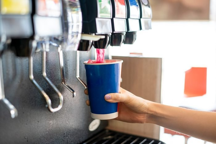 Man pours a fizzy drink.sparkling water.cool ice soft drink cola