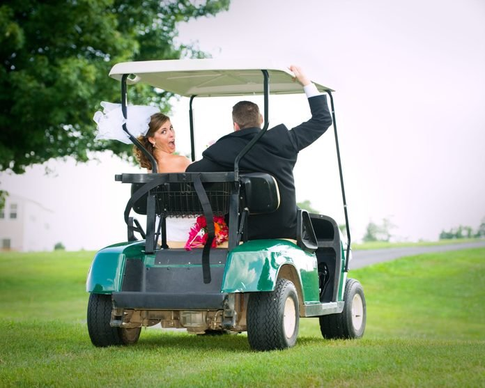 Runaway Bride and Groom in Golf Cart