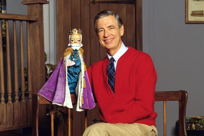 Fred Rogers on the set of Mister Rogers' Neighborhood with puppet King Friday