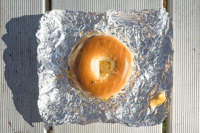 Bagel breakfast sandwich on tinfoil
