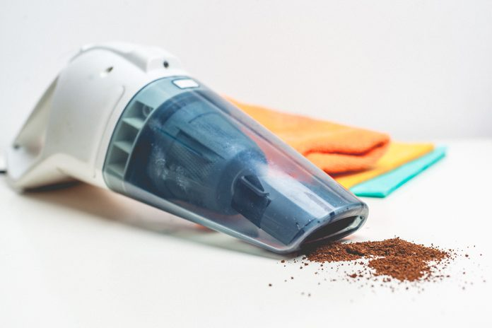 hand-held vacuum cleaner on a white background
