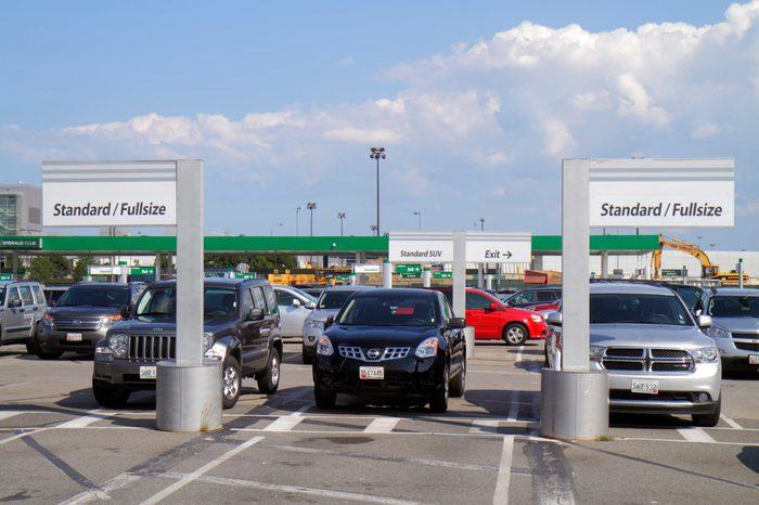 standard/fullsize signs at a car rental lot
