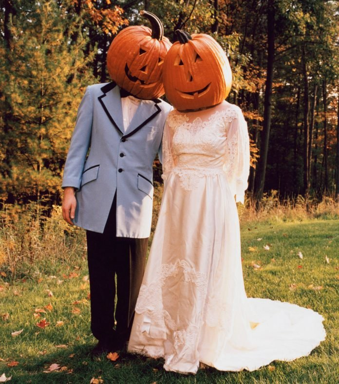 Couple with Pumpkin Heads