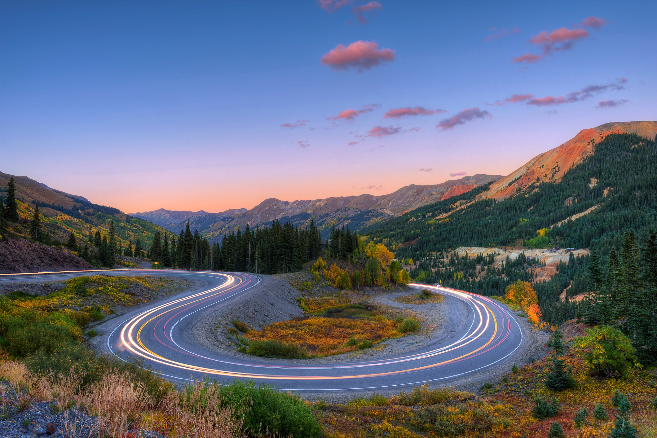 Light Trails on a switchback turn at sunset on the Million Dollar Highway, Colorado