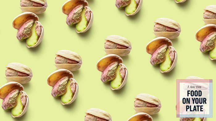 pattern of pistachios on green background