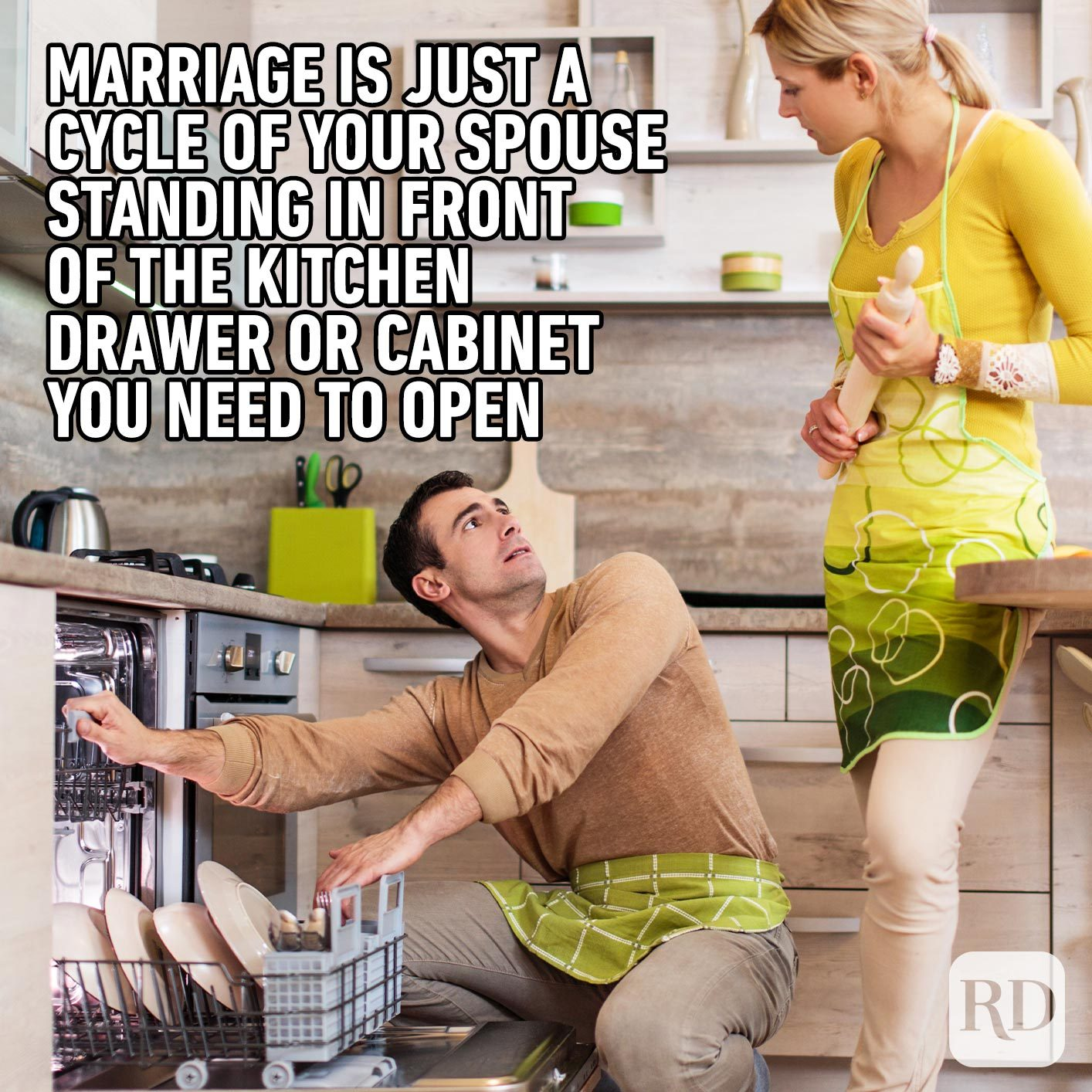 Woman waiting for man to step away from dishwasher. Meme text: Marriage is just a cycle of your spouse standing in front of the kitchen drawer or cabinet you need to open