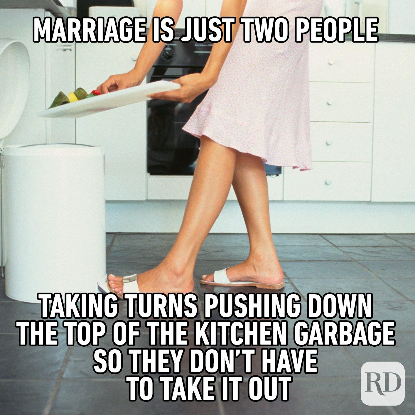 Woman pushing vegetables into the trash. Meme text: Marriage is just two people taking turns pushing down the top of the kitchen garbage so they don't have to take it out
