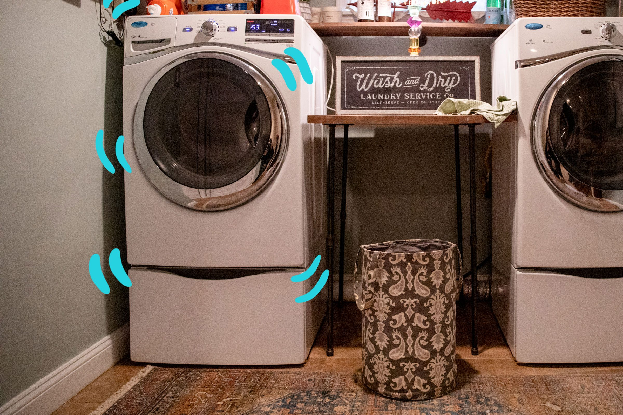 Washing machine with lines drawn to indicate shaking or vibrating