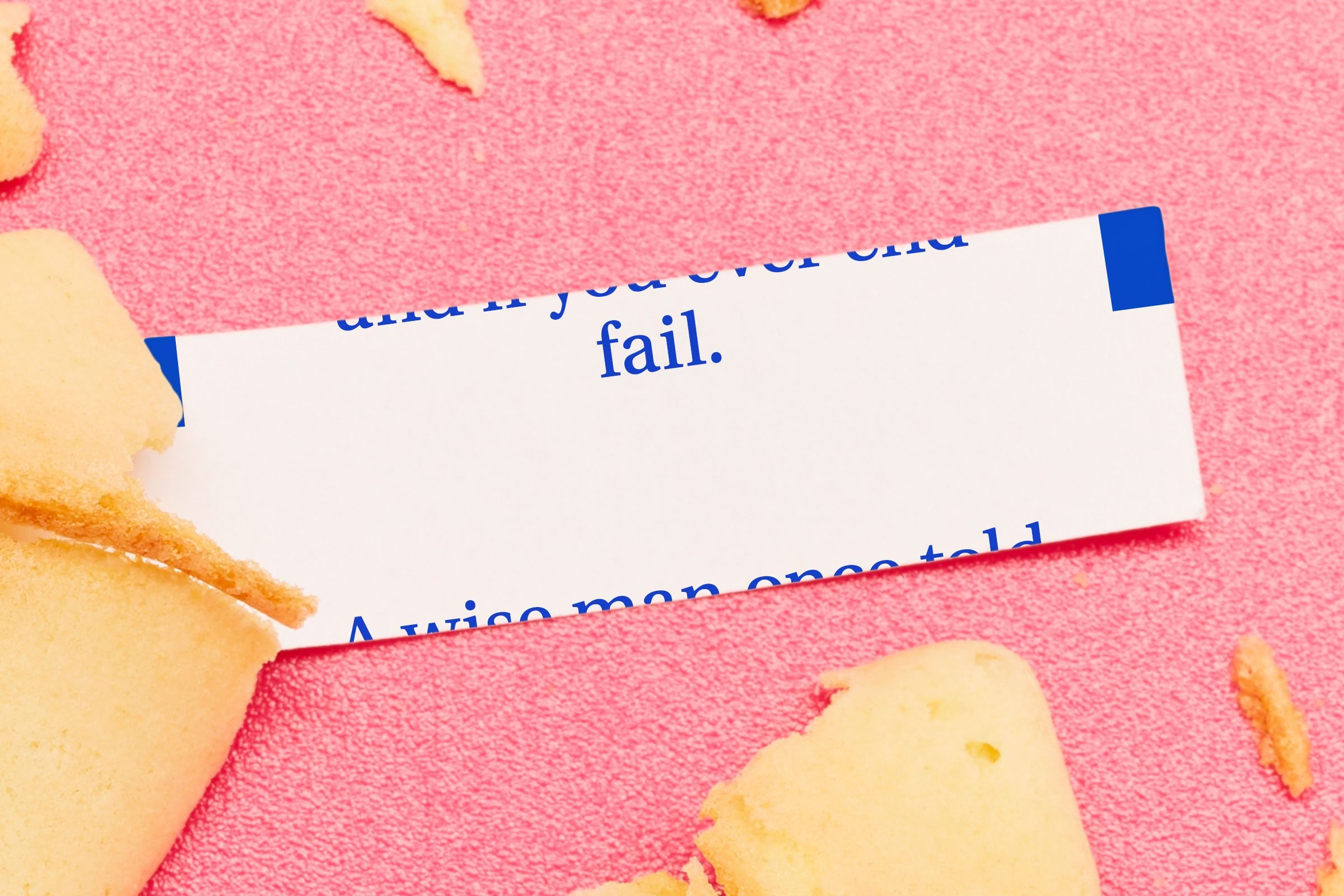"Fortune cookie with printing messed up so that you can only read the word ""fail"" and the rest is cut off."