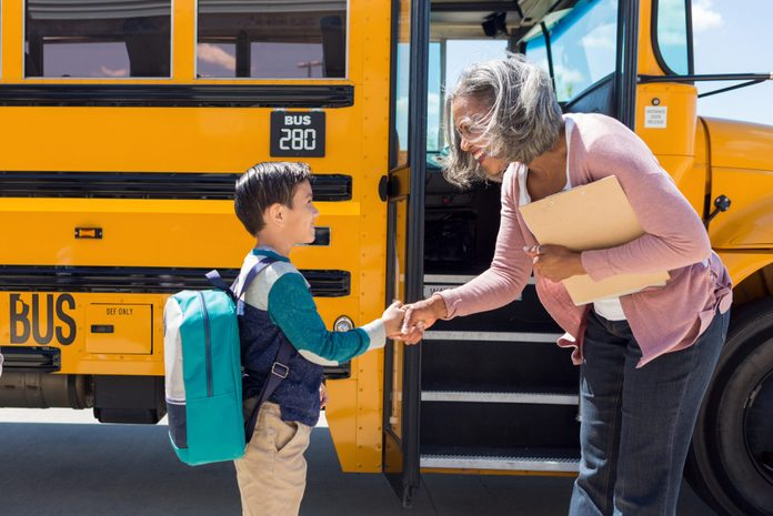 Schoolboy shakes his new bus driver's hand