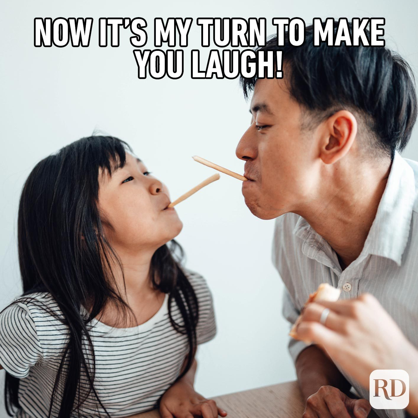 Girl and father with snack sticks in their mouths, smiling. Meme text: Now it's my turn to make you laugh!
