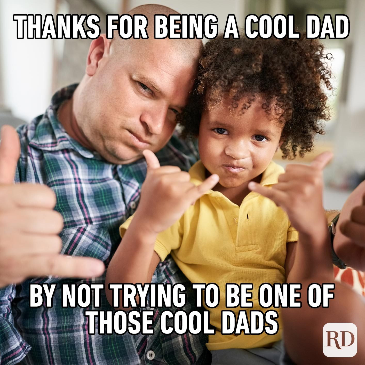 Child and father making the same hand signs. Meme text: Thanks for being a cool dad by not trying to be one of those cool dads