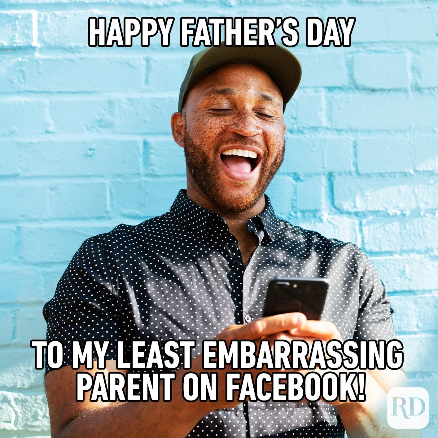 Man laughing at phone. Meme text: Happy Father's Day to my least embarrassing parent on Facebook!