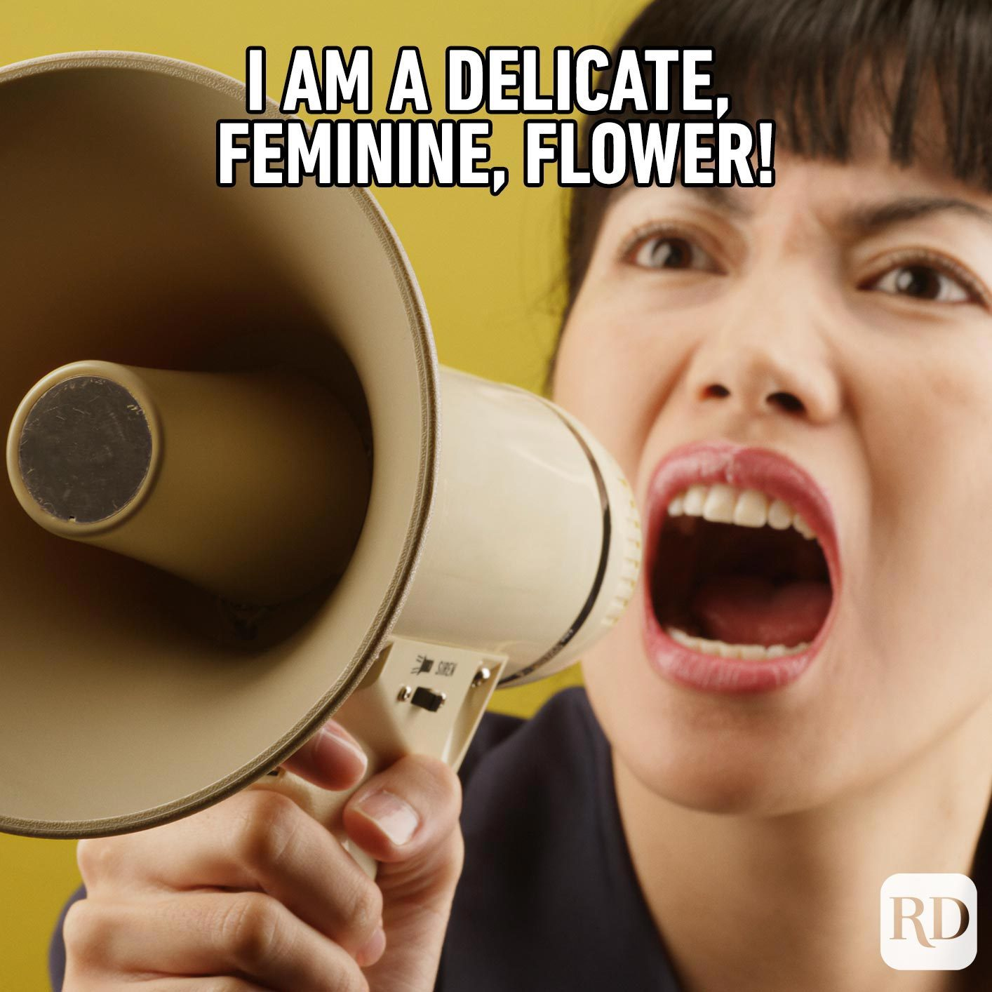 Woman shouting into megaphone with aggression. Meme text: I am a delicate, feminine, flower!