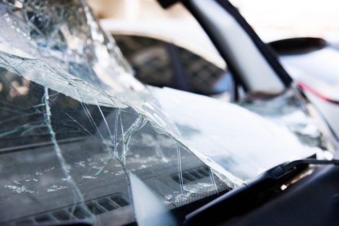 Broken windshield on a black car