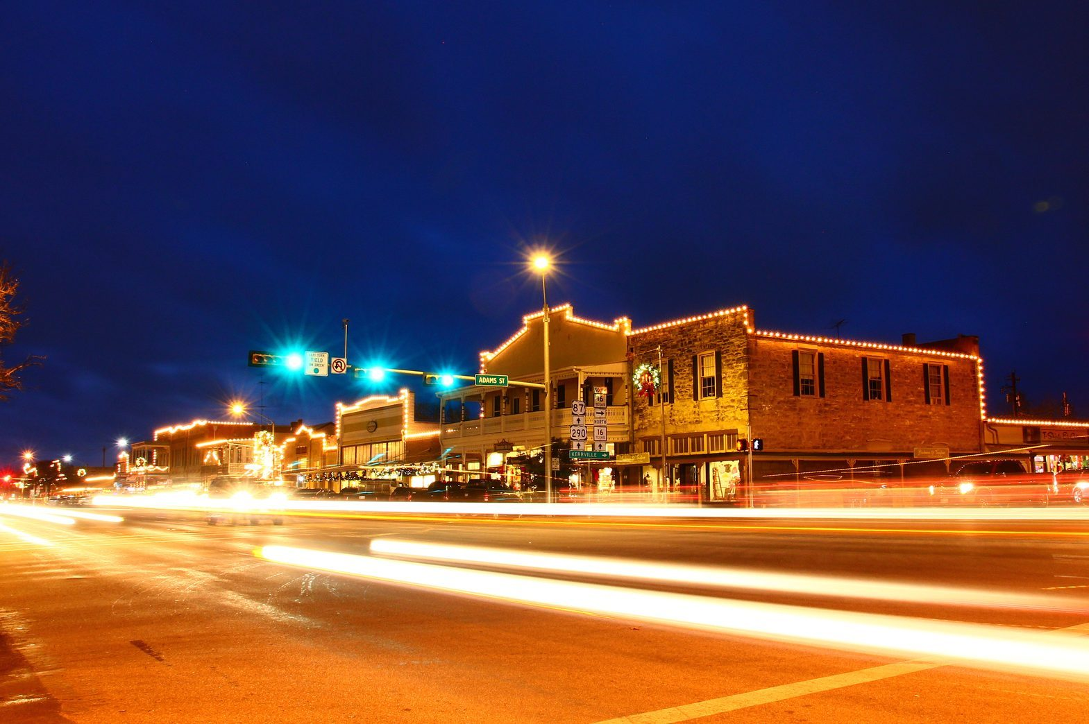 Beautiful city night scape of road and land transportation against lighting in Fredericksburg of Texas