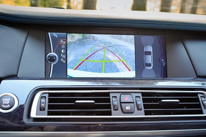 Interior of premium car with rearview camera dynamic trajectory turning lines and parking assistant. Driver assistance system for parking