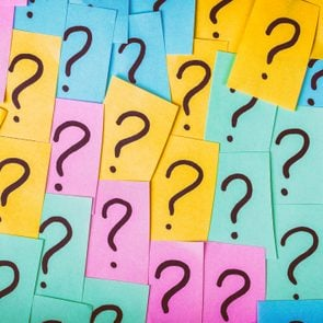Question marks written on slips of paper to represent riddle questions