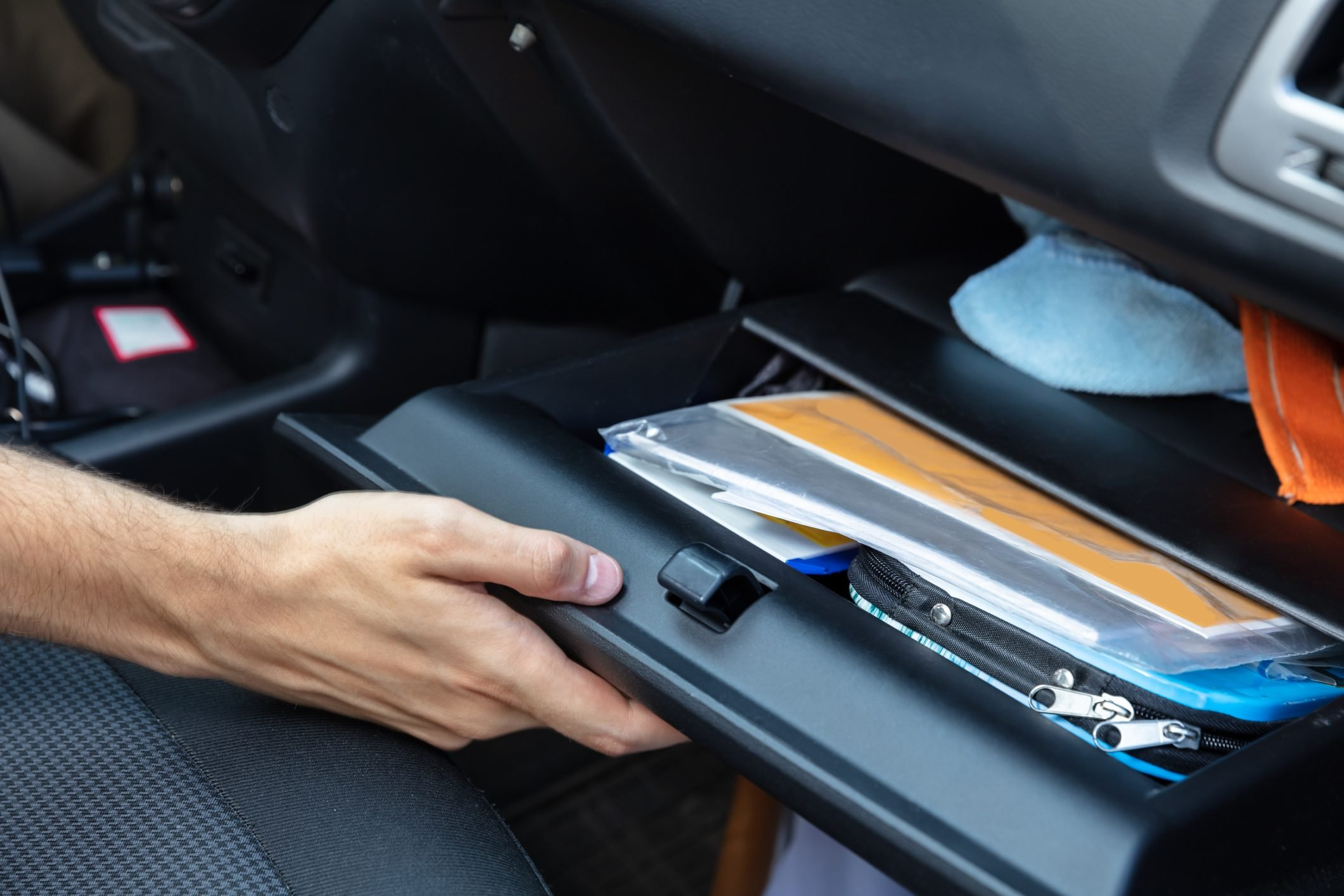 Driver Opening Glovebox Compartment