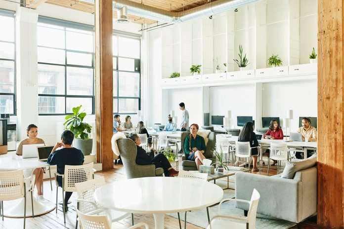 Interior view of businesspeople working in coworking office