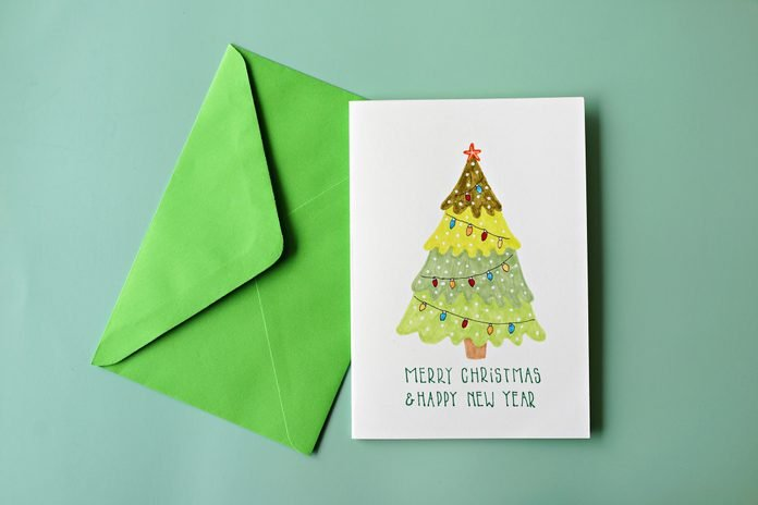 High Angle View Of Greeting Card On Green Background