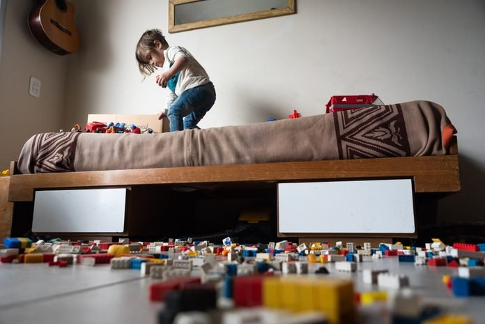 Boy Playing With Toy Blocks At Home