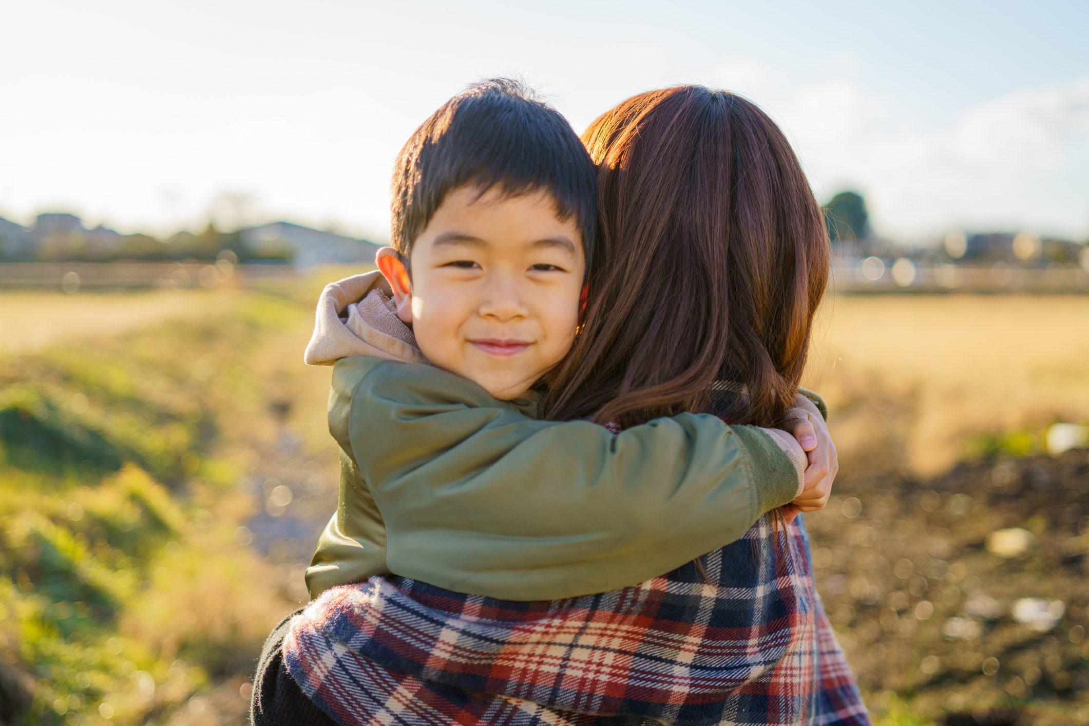 A boy hugging her mother