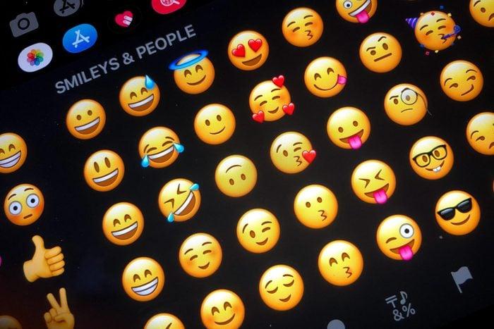 close up of emojis keyboard on an ipad or iphone in dark mode