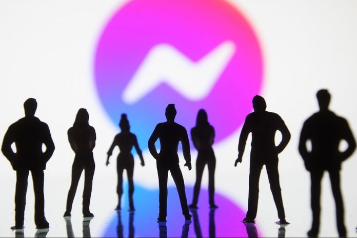 silhouetted figures of toy people seen displayed in front of a Facebook Messenger logo