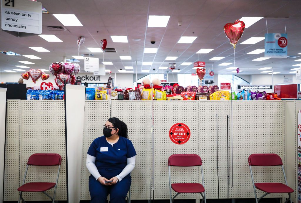 a woman waits in CVS for 15 minutes after receiving a covid-19 vaccine