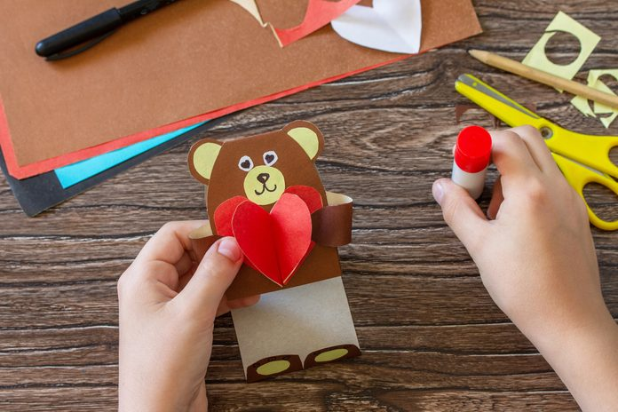 Instruction, step 13. On Mothers Day or Valentines Day gift - a teddy bear with a heart-card. Handmade paper ideas. Childrens creativity project, handmade, crafts for kids.