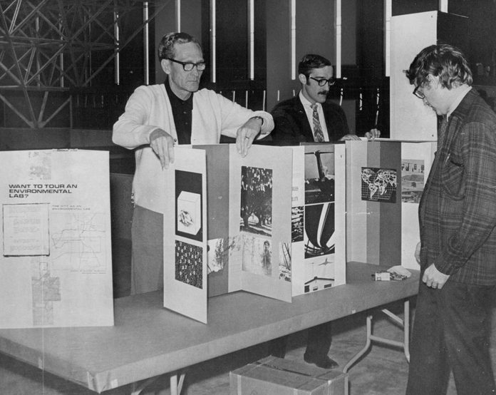 Preparations for Earth Day Teach - In Start; Readying a display booth at Currigan Hall are, from left. Charles Petersen, project officer, and Ed Harris and Bob Page, recreation resource specialists with the U.S. Department of the Interior Bureau of Outdoor Recreation; April 1970.
