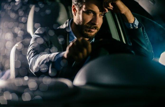 Handsome businessman in car