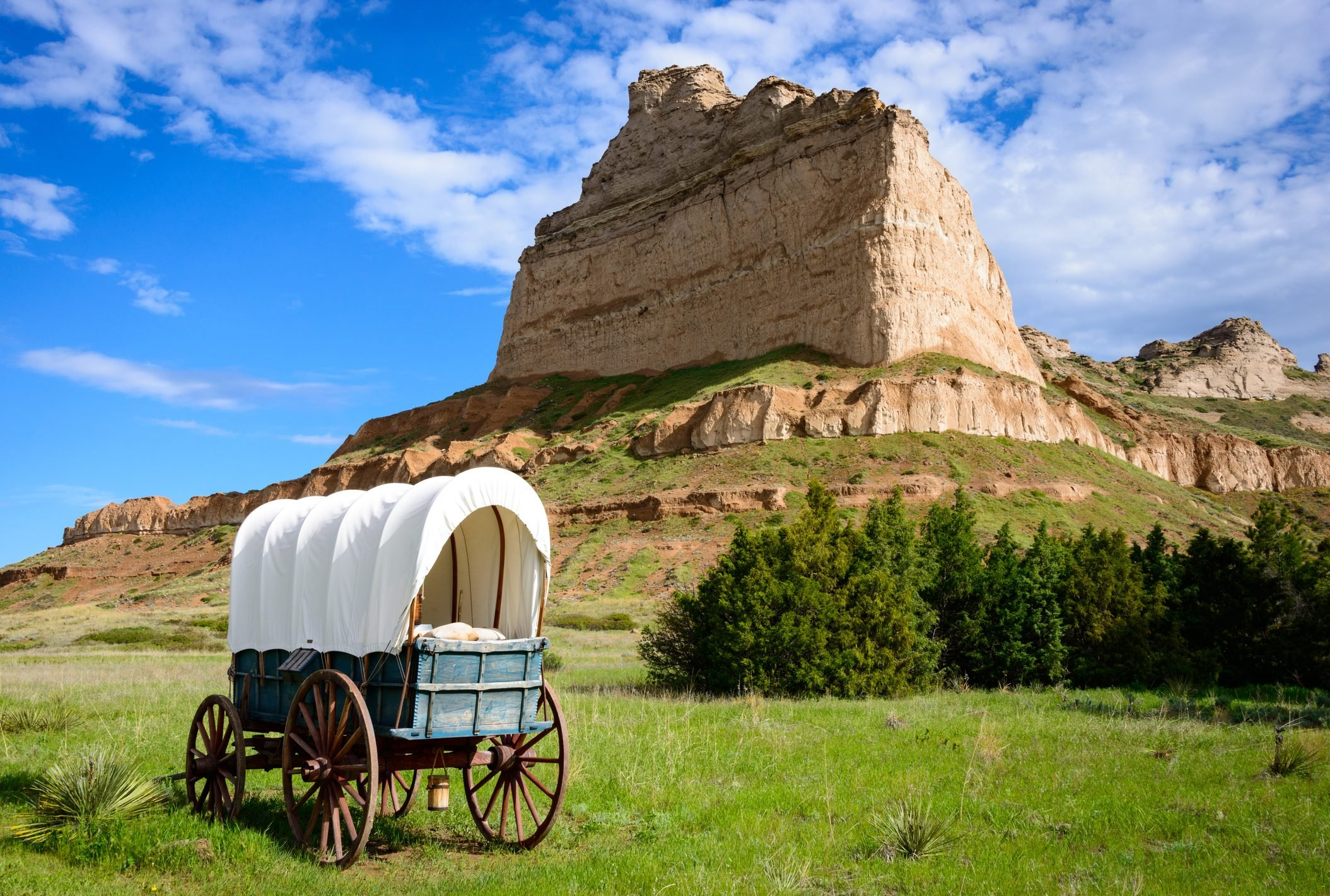covered wagon in a field at Scotts Bluff National Monument in Nebraska along the Oregon Trail