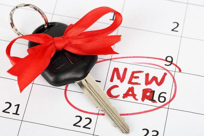 car key with ribbon on calendar background