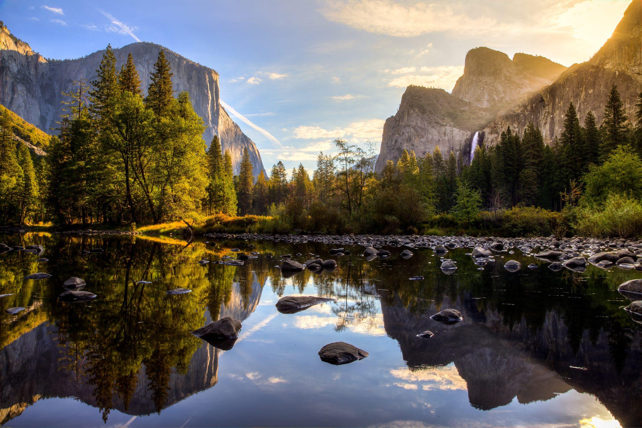 Sunrise on Yosemite Valley reflecting in the water at Yosemite National Park, California