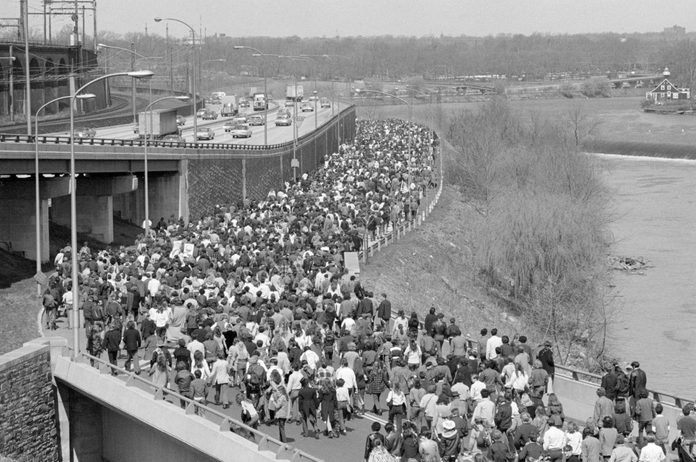 Thousands of young people stretched out over a mile walking along a closed river drive during a Philadelphia Earth Walk, April 22, 1970.