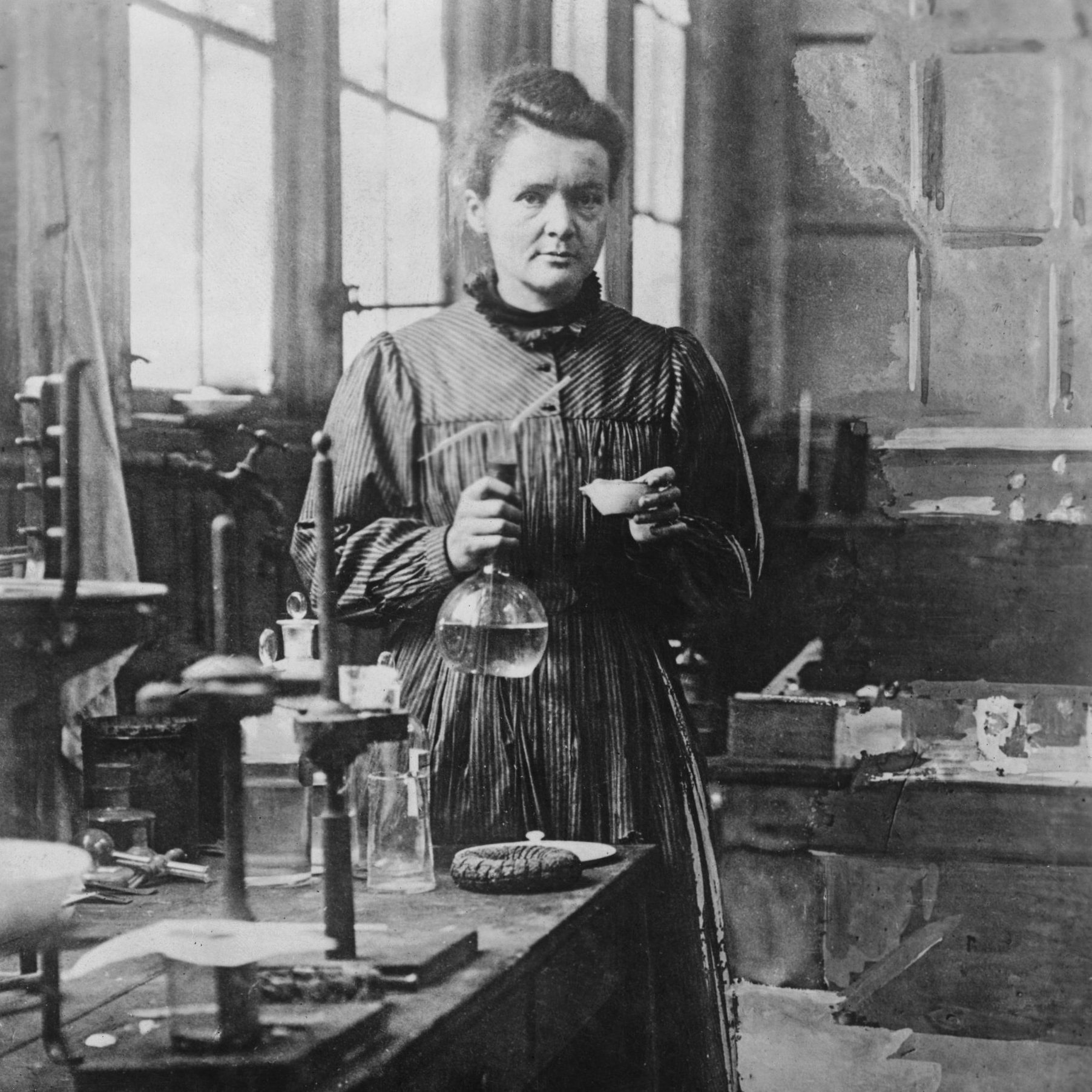Madame Curie (1867-1934), noted physical chemist, poses in her Paris laboratory. Undated photograph.