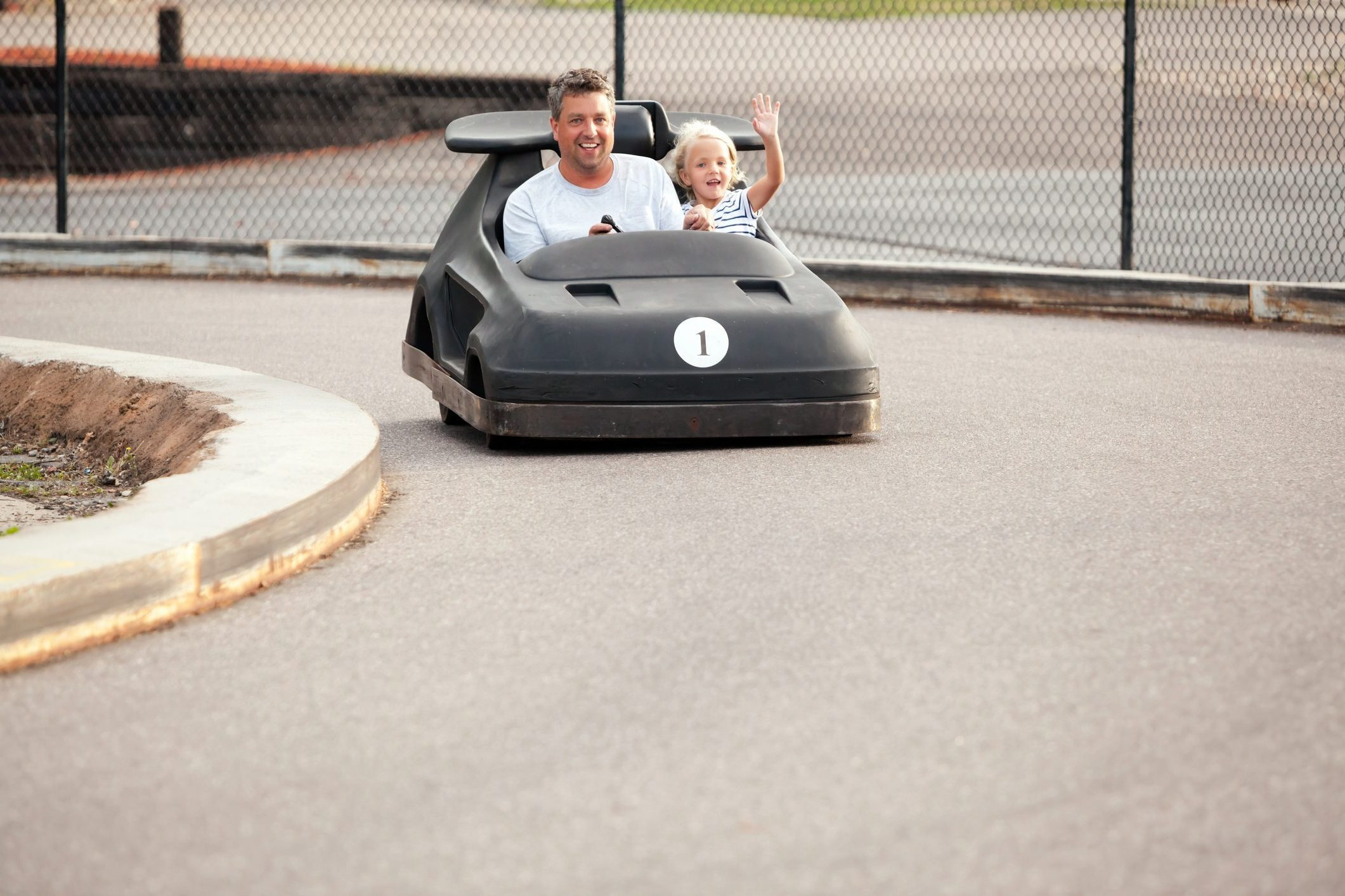 Father and Daughter Riding in Go Kart on Father's Day